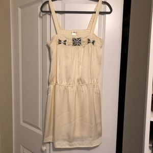 Cream colored dress with beaded detail